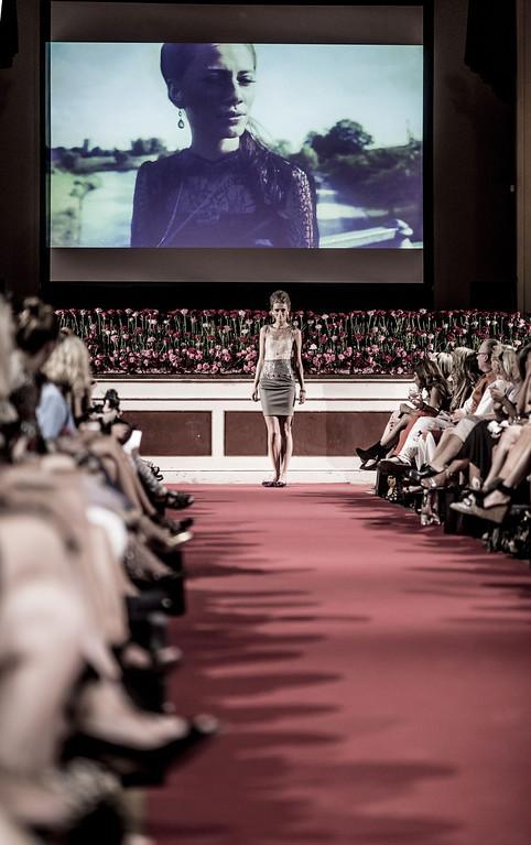 . A model shows off the designs during the JWLSCPH show at Copenhagen Fashion Week Spring/Summer 2014 in Copenhagen, Wednesday, Aug. 7, 2013. (AP Photo/Anthon Unger, POLFOTO)