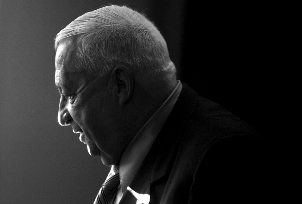 . In this Dec. 1, 2005 file photo, Israeli Prime Minister Ariel Sharon smiles during a question and answer session with Israeli news editors at the Journalist\'s Association in Tel Aviv, Israel. (AP Photo/Kevin Frayer, File)