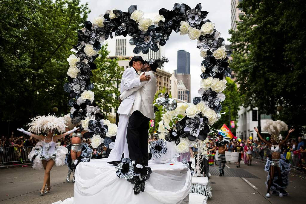 ". Two men of the White Branches float stage a mock wedding at the 40th annual Seattle Pride Parade Sunday, June 29, 2014, in Seattle, Wash. This year\'s theme was ìGenerations of Pride."" (AP Photo/seattlepi.com, Jordan Stead)"