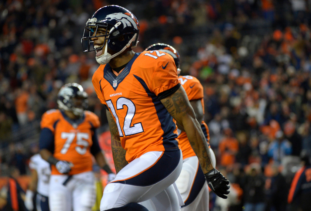 . Denver Broncos wide receiver Andre Caldwell (12) reacts to scoring a first quarter touchdown. The Denver Broncos vs. the San Diego Chargers at Sports Authority Field at Mile High in Denver on December 12, 2013. (Photo by Joe Amon/The Denver Post)