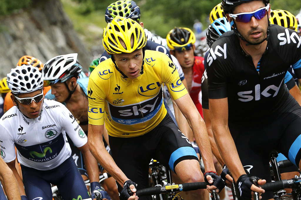 . Overall leader\'s yellow jersey Britain\'s Christopher Froome (C), best young\'s white jersey Colombia\'s Nairo Quintana ride in the pack during the 204.5 km nineteenth stage of the 100th edition of the Tour de France cycling race on July 19, 2013 between Bourg-d\'Oisans and Le Grand-Bornand, French Alps.  AFP PHOTO / JEFF PACHOUD/AFP/Getty Images