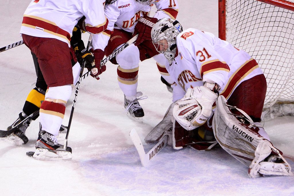 . DENVER, CO - MARCH 17: Juho Olkinuora (31) of the University of Denver Pioneers tends the net against the Colorado College Tigers during the first period of action. The University of Denver and Colorado College face off in the WCHA playoffs at Magness Arena. (Photo by AAron Ontiveroz/The Denver Post)