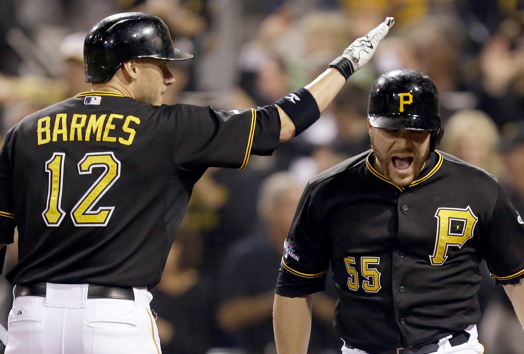 . Pittsburgh Pirates\' Russell Martin (55) is greeted by on-deck batter Clint Barmes (12) after hitting a home run in the second inning of the NL wild-card playoff baseball game against the Cincinnati Reds on Tuesday, Oct. 1, 2013, in Pittsburgh. (AP Photo/Gene J. Puskar)