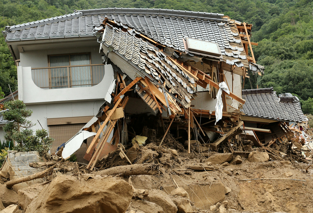 . A house destroyed by a landslide caused by torrential rain at the site of a landslide in a residential area on August 20, 2014 in Hiroshima, Japan.  (Photo by Buddhika Weerasinghe/Getty Images)