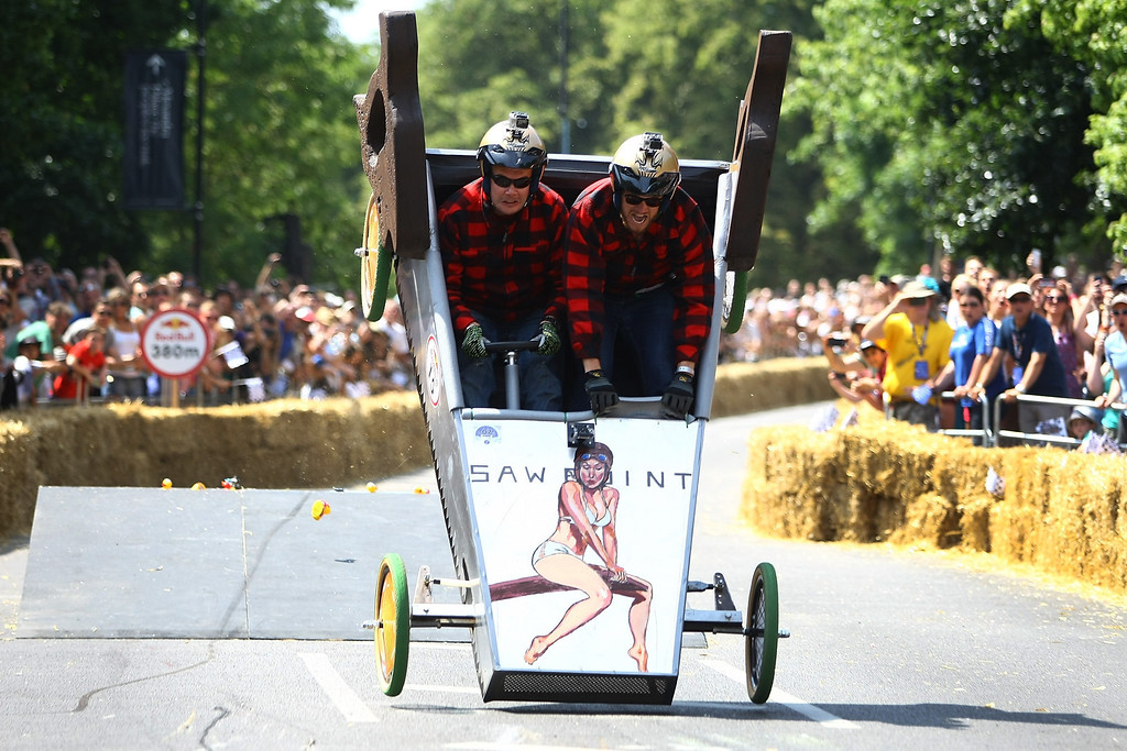. A team goes over a jump in their soapbox racer at Alexandra Palace on July 14, 2013 in London, England. The Red Bull Soapbox Race returned to London after nine years and encourages competitors to build and race their own homemade soapboxes down a hill.  (Photo by Jordan Mansfield/Getty Images)