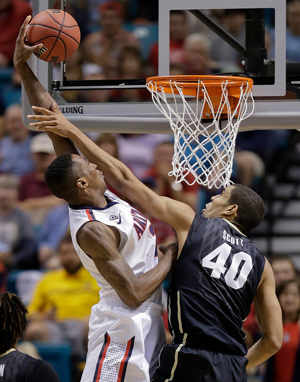 . Arizona\'s Rondae Hollis-Jefferson dunks the ball over Colorado\'s Josh Scott during the second half of an NCAA college basketball game in the semifinals of the Pac-12 Conference on Friday, March 14, 2014, in Las Vegas. Arizona won 63-43. (AP Photo/Julie Jacobson)