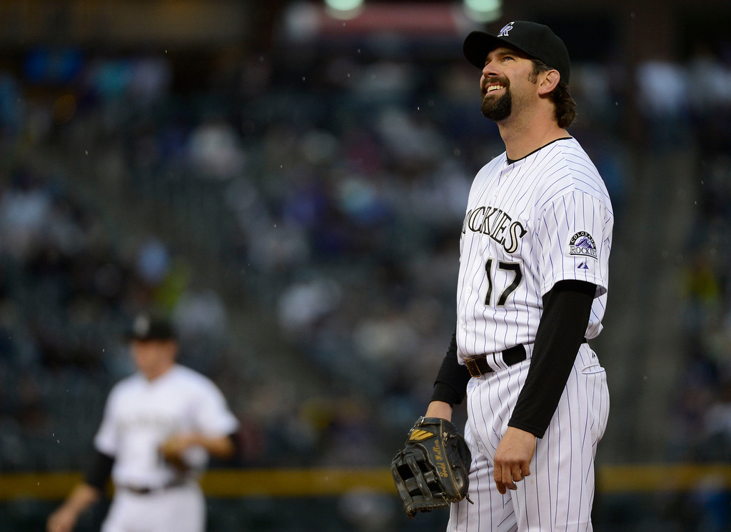 . DENVER, CO. - MAY 07: Todd Helton (17) of the Colorado Rockies looks up at the dark skies during their game against the New York Yankees May 7, 2013 at Coors Field. (Photo By John Leyba/The Denver Post)