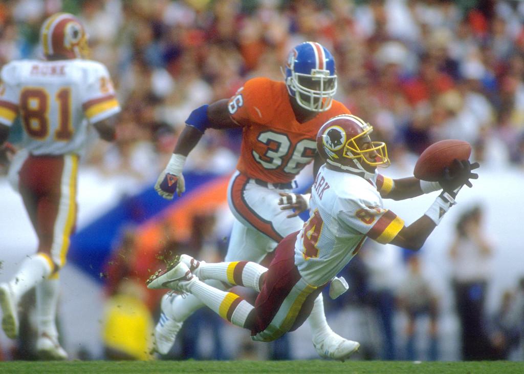. Redskins wide receiver Gary Clark #84 makes a diving catch during Super Bowl XXII against the Denver Broncos. Rick Stewart/Allsport