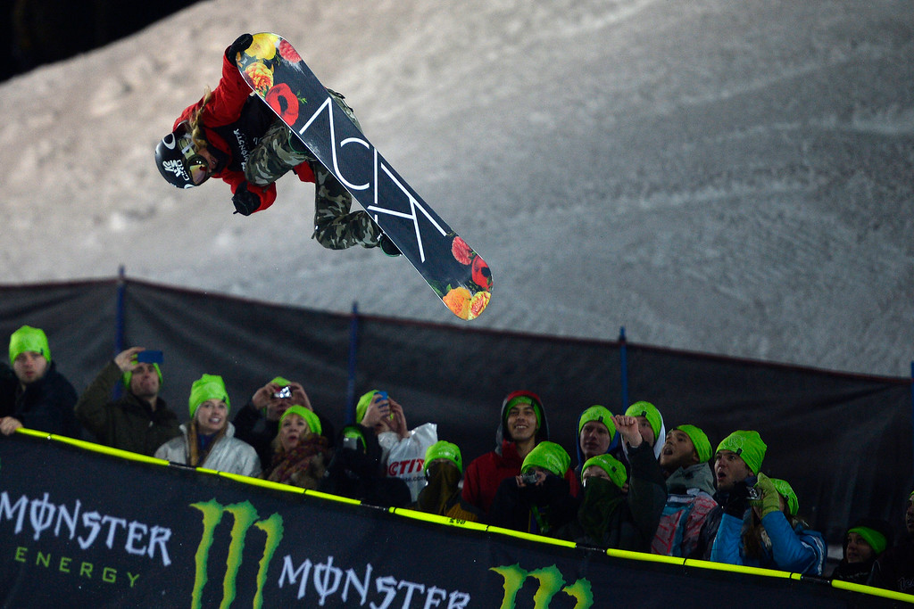 . Gretchen Bleiler makes a grab during the women\'s snowboard halfpipe. X Games Aspen at Buttermilk on Friday, January 25, 2014. (Photo by AAron Ontiveroz/The Denver Post)