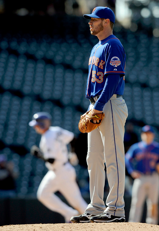 . New York Mets starting pitcher Jeremy Hefner looks on after giving up a solo home run to Colorado Rockies\' Troy Tulowitzki during the eighth inning of a baseball game, Thursday, April 18, 2013, in Denver. (AP Photo/Jack Dempsey)