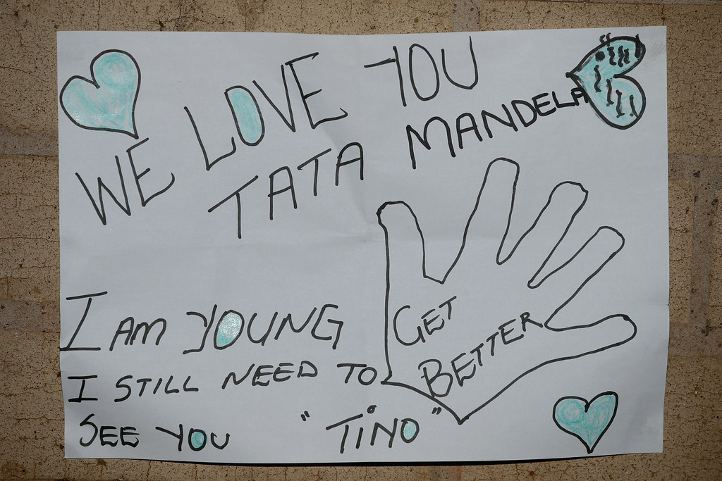 . PRETORIA, SOUTH AFRICA - JUNE 25:  One of the dozens of hand-made messages of support for former South African President Nelson Mandela posted to the wall outside the Mediclinic Heart Hospital June 25, 2013 in Pretoria, South Africa. South African President Jacob Zuma confirmed Sunday that Mandela\'s condition has become critical since he was admitted to the hospital over two weeks ago for a recurring lung infection.  (Photo by Chip Somodevilla/Getty Images)