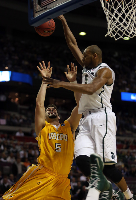 . Bobby Capobianco #5 of the Valparaiso Crusaders drives for a shot attempt in the first half against Adreian Payne #5 of the Michigan State Spartans during the second round of the 2013 NCAA Men\'s Basketball Tournament at at The Palace of Auburn Hills on March 21, 2013 in Auburn Hills, Michigan.  (Photo by Jonathan Daniel/Getty Images)