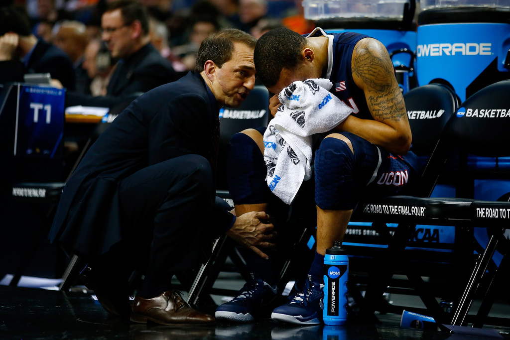 . BUFFALO, NY - MARCH 22:  Shabazz Napier #13 of the Connecticut Huskies receives medical attention for his leg during the third round of the 2014 NCAA Men\'s Basketball Tournament against the Villanova Wildcats at the First Niagara Center on March 22, 2014 in Buffalo, New York.  (Photo by Jared Wickerham/Getty Images)