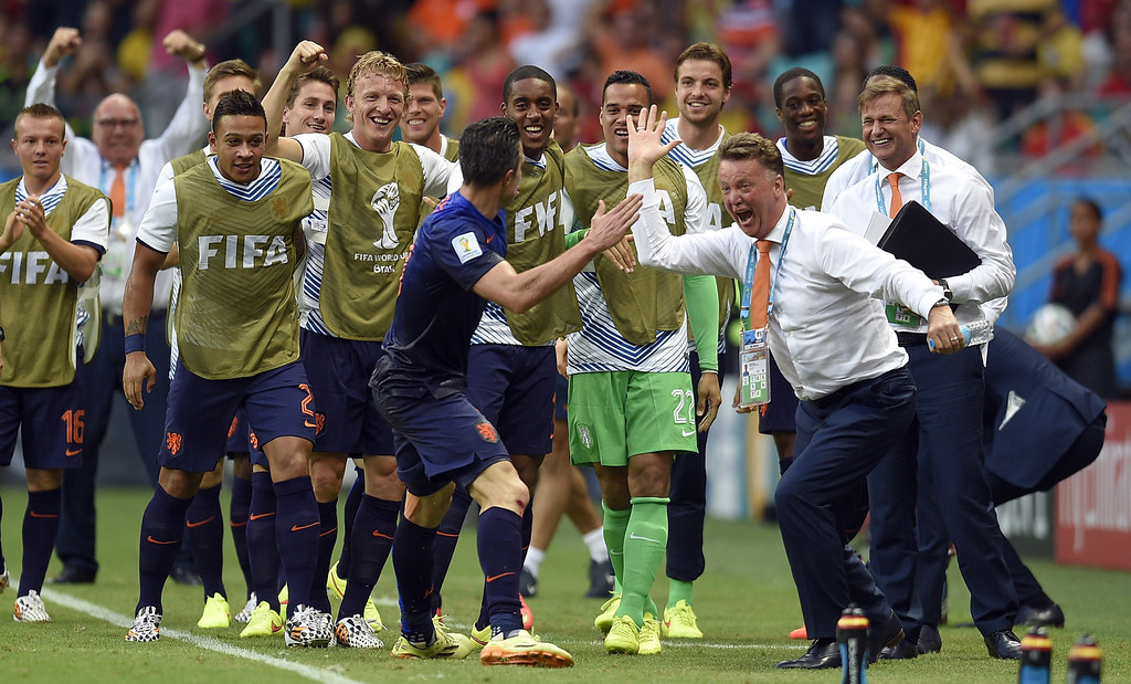 . Netherlands\' forward Robin van Persie (L) celebrates with Netherlands\' coach Louis van Gaal (R) after scoring during a Group B football match between Spain and the Netherlands at the Fonte Nova Arena in Salvador during the 2014 FIFA World Cup on June 13, 2014. LLUIS GENE/AFP/Getty Images
