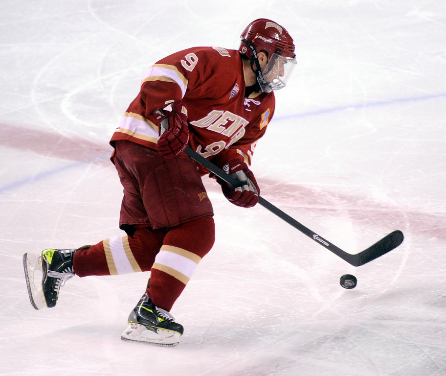 . DENVER, CO. - OCTOBER 25: Denver left wing Gabe Levin skated with the puck in the second period. The University of Denver hockey team hosted Niagara at Magness Arena Friday night, October 25, 2013. Photo By Karl Gehring/The Denver Post