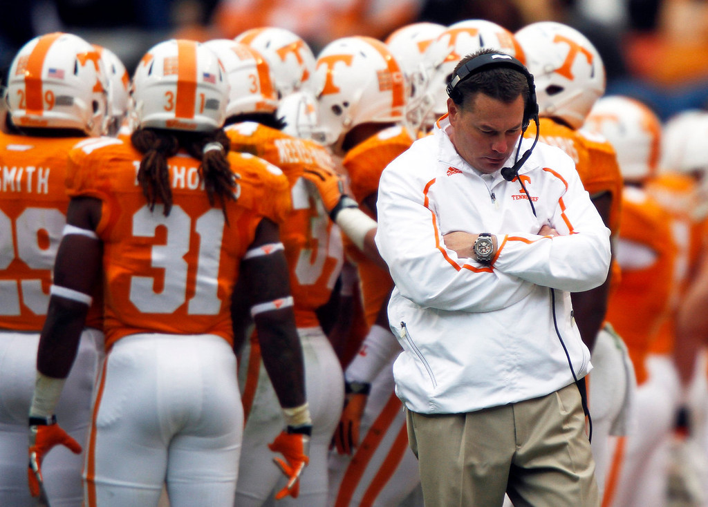 . Tennessee coach Butch Jones walks away from the huddle during a timeout in the fourth quarter of an NCAA college football game against Auburn on Saturday, Nov. 9, 2013 in Knoxville, Tenn. Auburn won 55-23. (AP Photo/Wade Payne)