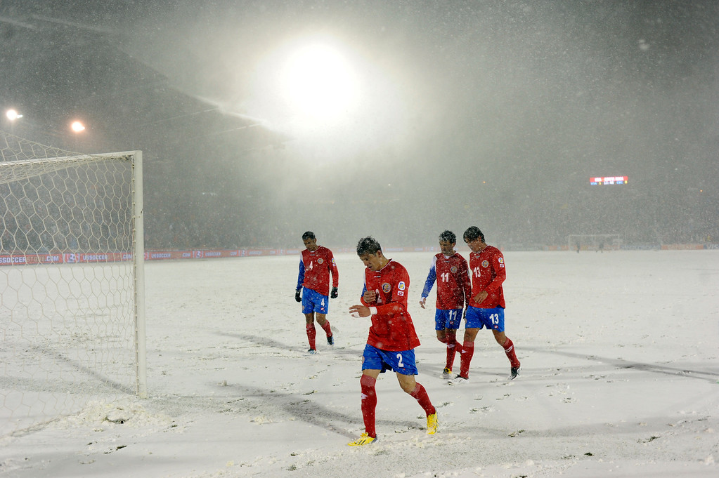 . COMMERCE CITY, CO. - MARCH 22: Costa Rican players cleared the field at halftime Friday night as weather conditions deteriorated. The U.S. Men\'s National Soccer Team hosted Costa Rica Friday night, March 22, 2013 in a FIFA World Cup qualifier at Dick\'s Sporting Goods Park in Commerce City.  (Photo By Karl Gehring/The Denver Post)