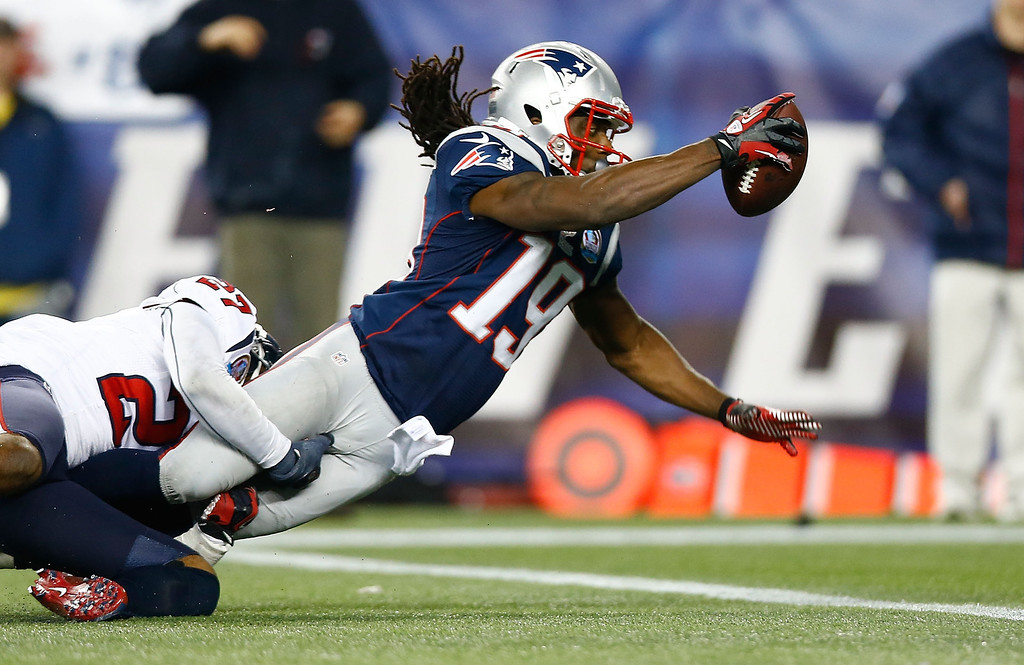 . FOXBORO, MA - DECEMBER 10: Donte\' Stallworth #19 of the New England Patriots dives across the goal line to score a touchdown in the third quarter against the Houston Texans during the game at Gillette Stadium on December 10, 2012 in Foxboro, Massachusetts. (Photo by Jared Wickerham/Getty Images)