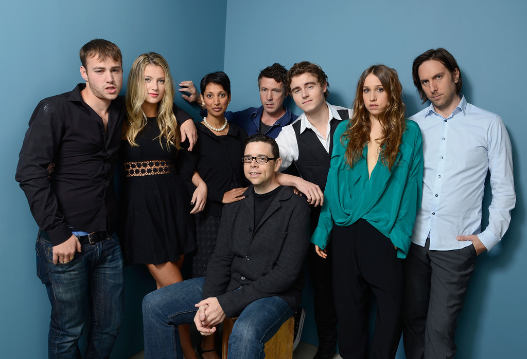 . (L-R) Actor Emory Cohen, actress Zoe Levin, director Gita Pullapilly, director Aron Gaudet, actor Aidan Gillen, actor Callan McAuliffe, actress Sarah Sutherland and actor Timm Sharp of \'Beneath The Harvest Sky\' poses at the Guess Portrait Studio during 2013 Toronto International Film Festival on September 8, 2013 in Toronto, Canada.  (Photo by Larry Busacca/Getty Images)