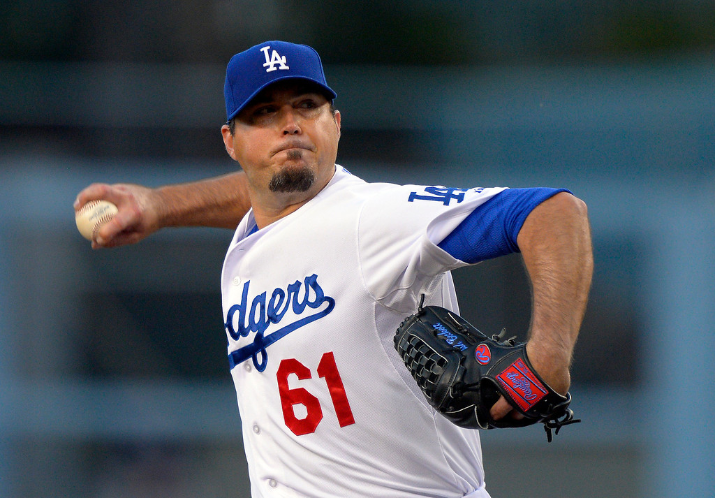 . Los Angeles Dodgers starting pitcher Josh Beckett throw to the plate during the first inning of their baseball game against the Colorado Rockies, Wednesday, May 1, 2013, in Los Angeles. (AP Photo/Mark J. Terrill)