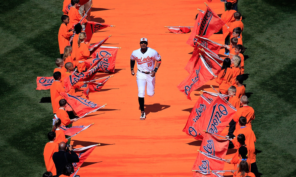 . Adam Jones #10 of the Baltimore Orioles is introduced  before the start of the Orioles Opening Day game a Boston Red Sox at Oriole Park at Camden Yards on March 31, 2014 in Baltimore, Maryland.  (Photo by Rob Carr/Getty Images)