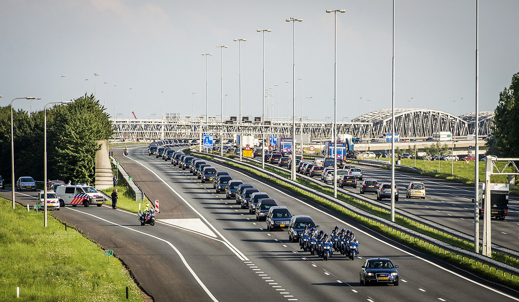 . A convoy of hearses carry the remains of the victims of the Malaysia Airlines flight MH17 plane crash from an airbase in Eindhoven to Hilversum, The Netherlands, drives through Waardenburg on July 24, 2014, after a Dutch Air Force C-130 Hercules plane and an Australian Royal Australian Air Force C17 transporting the remains arrived from Kharkiv, Ukraine. Dozens more bodies from the crash site of Malaysia Airlines flight MH17 are set to arrive in the Netherlands on July 24, as the EU prepares to hit Russia with fresh sanctions. AFP PHOTO / ANP / REMKO DE WAAL /AFP/Getty Images