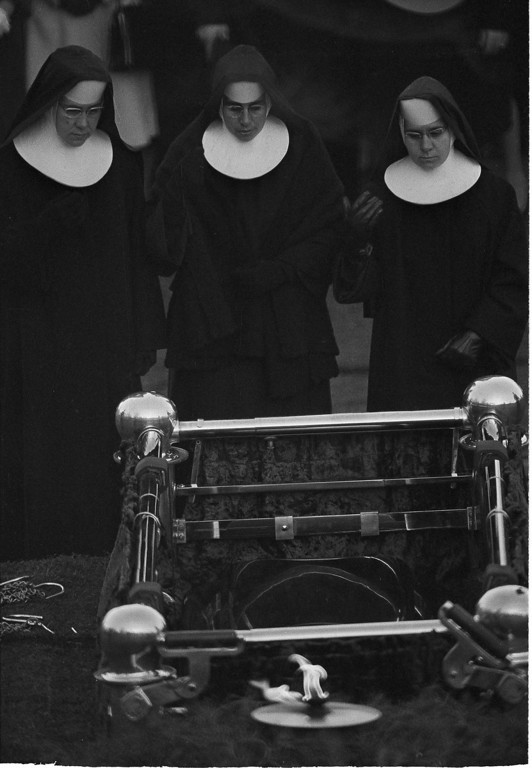 . Three Roman Catholic nuns pay their final respects.  Kennedy was the first Roman Catholic elected to the presidency.  Associated Press file