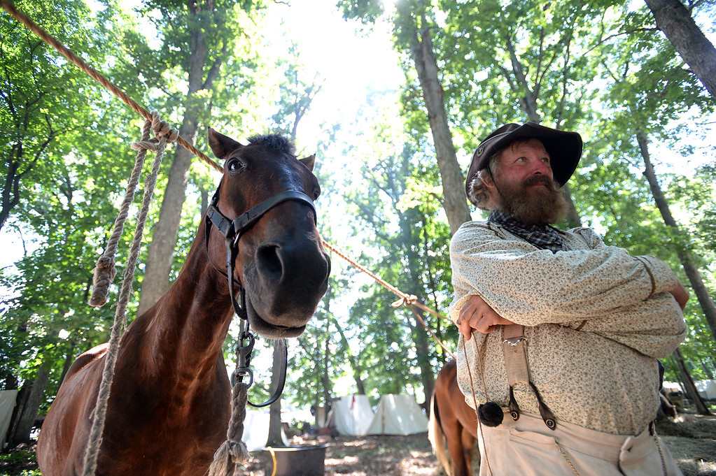 """. Bob Green of Polo, Mo a member of \""""Elliot Scouts\"""" 9th Missouri Cavalry Co. B and his favortie horse, Ringo, relax at the Confederate Cavalry camp at the Blue Gray Alliance re-enactment at the Bushey Farm on June 29, 2013. LEBANON DAILY NEWS - JEREMY LONG"""