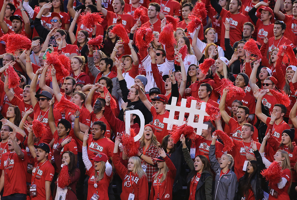. Fans of the Utah Utes cheer during a game against the of the Stanford Cardinal during the first half of an NCAA football game October 12, 2013 at Rice Eccles Stadium in Salt Lake City, Utah. Utah Beat Stanford 27-21. (Photo by George Frey/Getty Images)