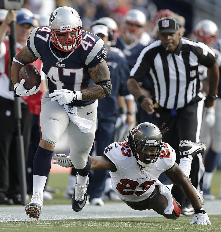. Michael Hoomanawanui #47 of the New England Patriots breaks free of Mark Barron #23 of the Tampa Bay Buccaneers during the second half of New England\'s  23-3 win at Gillette Stadium on September 22, 2013 in Foxboro, Massachusetts.  (Photo by Winslow Townson/Getty Images)