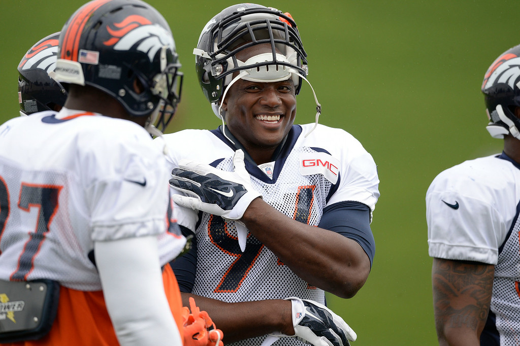 . Denver Broncos defensive end DeMarcus Ware (94) returns to practice  as he talks with Denver Broncos outside linebacker Von Miller (58) on day seven of the Denver Broncos 2014 training camp July 31, 2014 at Dove Valley. (Photo by John Leyba/The Denver Post)