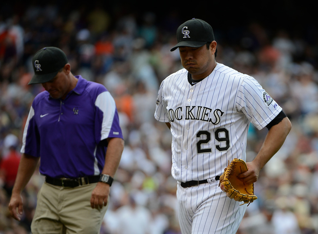 . DENVER, CO - JUNE 27: Colorado Rockies pitcher, Jorge De La Rosa, walks off the field with a trainer at the top of the seventh inning against the San Francisco Giants at Coors Field Saturday afternoon, June 29, 2013.  (Photo By Andy Cross/The Denver Post)