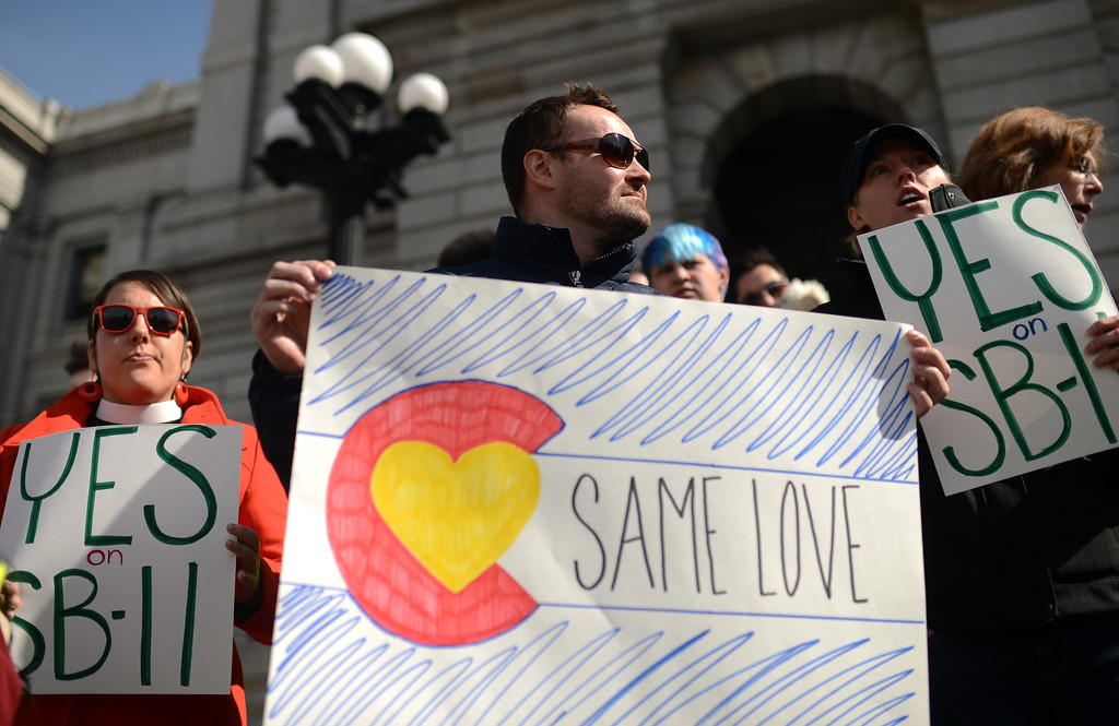 . DENVER, CO. - FEBRUARY 28: Charlie Roberts of Denver and supporters of Colorado Civil Union Act gather in front of Colorado State Capitol building. February 28, 2013. Denver, Colorado. (Photo By Hyoung Chang/The Denver Post)