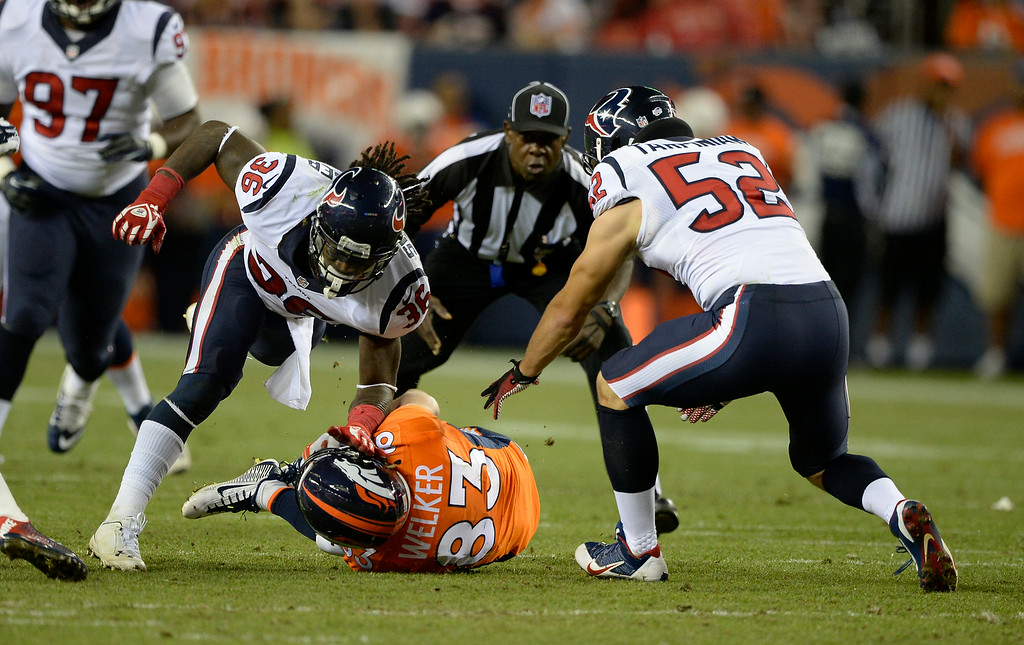 . DENVER, CO - AUGUST 23: Houston Texans strong safety D.J. Swearinger (36) puts a big hit on Denver Broncos wide receiver Wes Welker (83) after a catch up the middle during the second quarter August 23, 2014 at Sports Authority Field at Mile High Stadium. D.J. Swearinger; was flagged on the play. (Photo by John Leyba/The Denver Post)