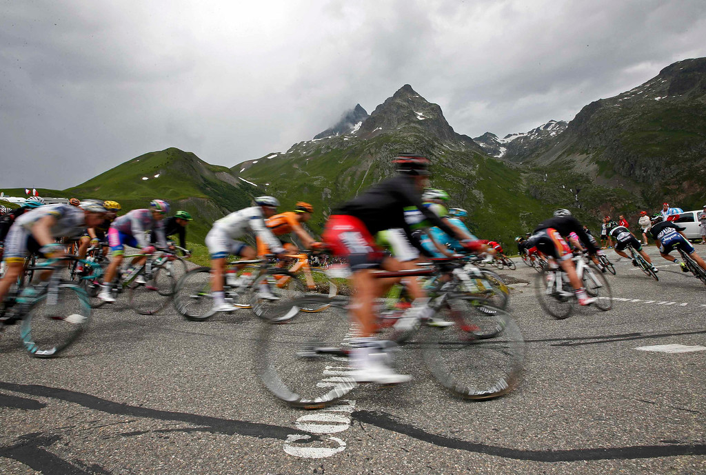 . The pack of riders cycles during the 204.5 km stage of the centenary Tour de France cycling race from Bourg d\'Oisans to Le Grand Bornand, in the French Alps, July 19, 2013.  REUTERS/Eric Gaillard