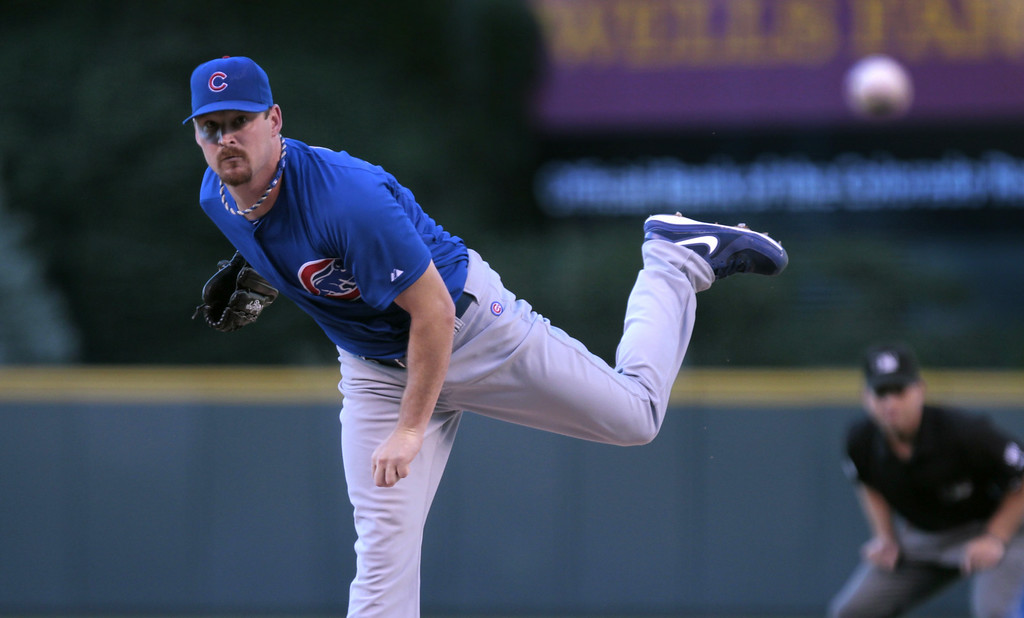 . Chicago Cubs starting pitcher Travis Wood (37) delivers against the Colorado Rockies in the first inning of a baseball game in Denver on Tuesday, Aug. 5, 2014.(AP Photo/Joe Mahoney)