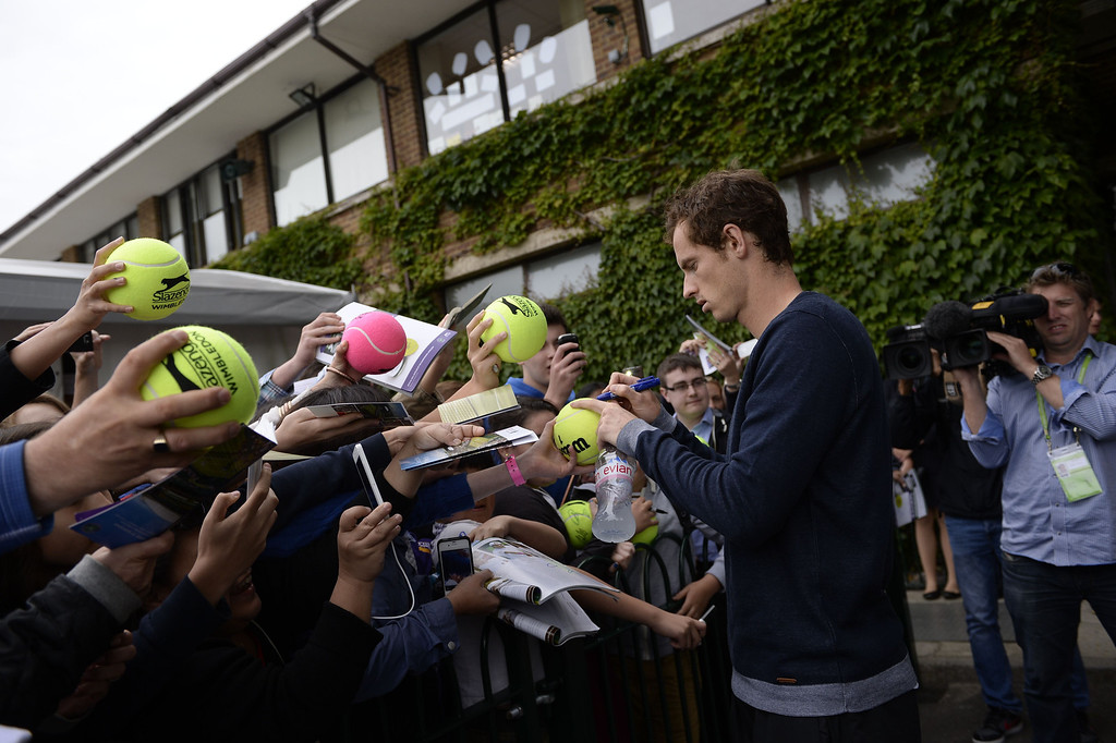 . Britain\'s Andy Murray signs autographs for fans after a training session at the practice courts on day eight of the 2013 Wimbledon Championships tennis tournament at the All England Club in Wimbledon, southwest London, on July 2, 2013. ADRIAN DENNIS/AFP/Getty Images