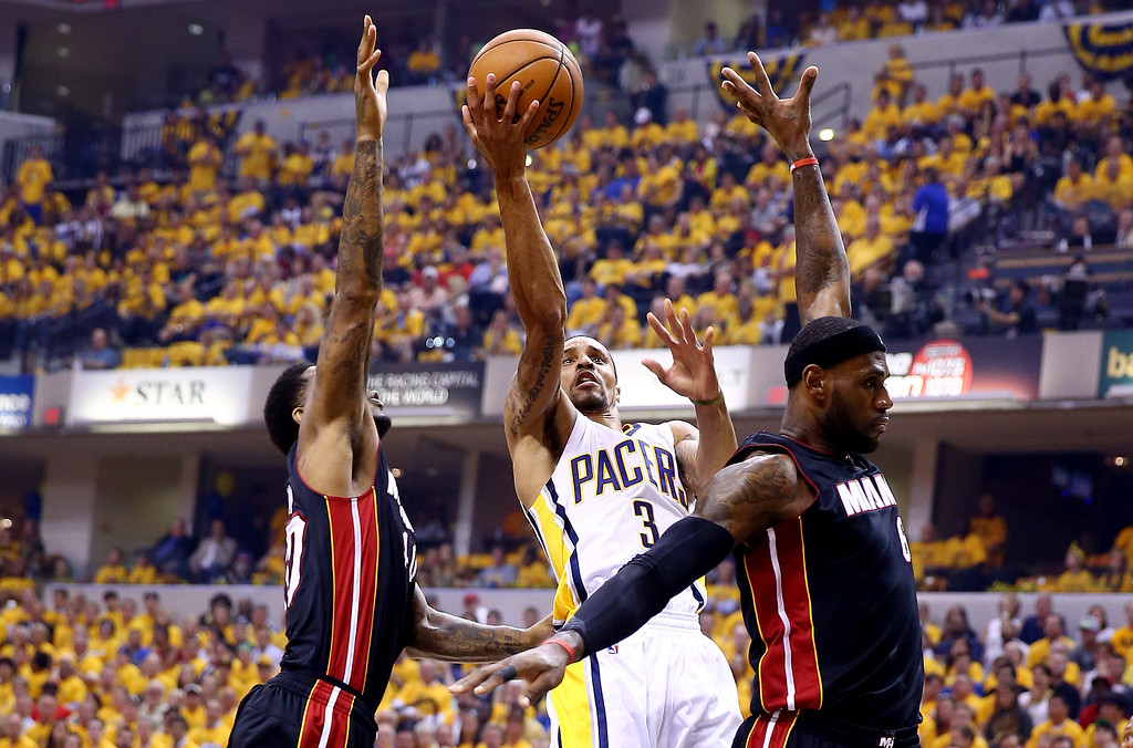 . INDIANAPOLIS, IN - MAY 28:  George Hill #3 of the Indiana Pacers goes to the basket as LeBron James #6 and Udonis Haslem #40 of the Miami Heat defend during Game Five of the Eastern Conference Finals of the 2014 NBA Playoffs at Bankers Life Fieldhouse on May 28, 2014 in Indianapolis, Indiana.  (Photo by Andy Lyons/Getty Images)
