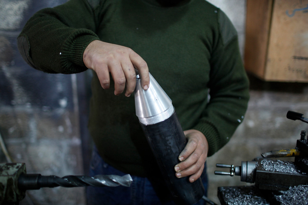 . A Free Syrian Army fighter makes homemade missiles at a workshop in north Aleppo December 29, 2012.REUTERS/Ahmed Jadallah