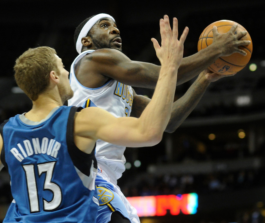. Denver guard Ty Lawson (3) sailed past Minnesota defender Luke Ridnour (15) in the second half. The Minnesota Timberwolves took a bite out of the Denver Nuggets winning 101-97 at the Pepsi Center Thursday night, January 3, 2013. Karl Gehring/The Denver Post