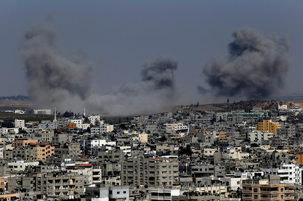 . Smoke rises after an Israeli strike hit Gaza City, northern Gaza Strip, Thursday, July 31, 2014.(AP Photo/Lefteris Pitarakis)