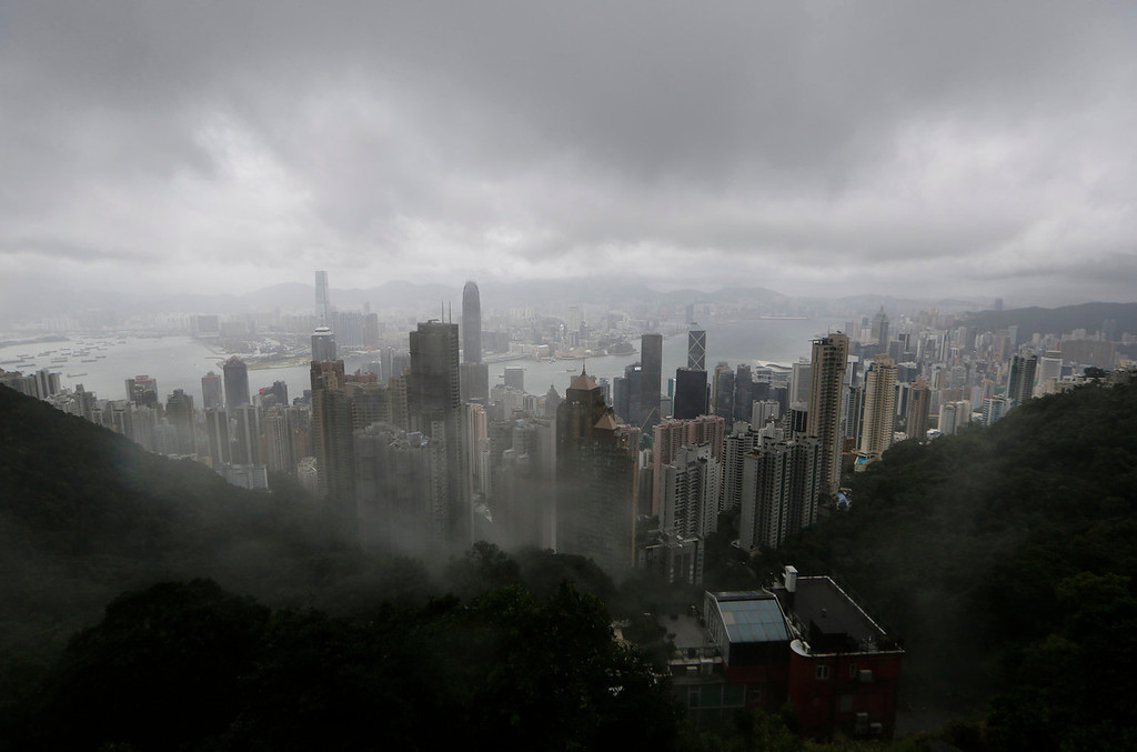 . The clouds are hanging low over the city of Hong Kong, seen from the Victoria Peak, in Hong Kong Tuesday, Aug. 13, 2013. The Observatory said Typhoon Utor intensified slightly as it moves towards the western coast of Guangdong. The typhoon battered the northern Philippines on Monday, toppling power lines and dumping heavy rain across cities and food-growing plains. (AP Photo/Kin Cheung)