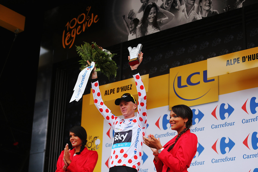 . ALPE D\'HUEZ, FRANCE - JULY 18:  Chris Froome of Great Britain and Team Sky Procycling reacts on the podium as he retains the King of the Mountains climbers polka dot jersey following stage eighteen of the 2013 Tour de France, a 172.5KM road stage from Gap to l\'Alpe d\'Huez, on July 18, 2013 in Alpe d\'Huez, France.  (Photo by Bryn Lennon/Getty Images)