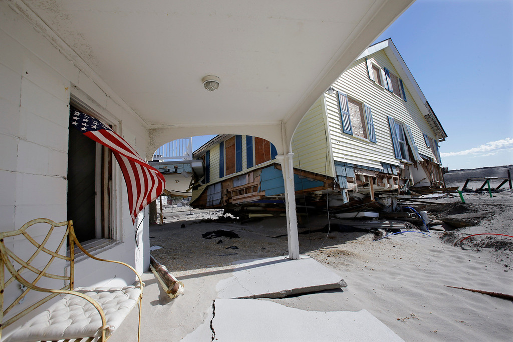 . Homes destroyed last October by Superstorm Sandy are seen Thursday, April 25, 2013, in Brick, N.J. Six months after Sandy devastated the Jersey shore and New York City and pounded coastal areas of New England, the region is dealing with a slow and frustrating, yet often hopeful, recovery. (AP Photo/Mel Evans)