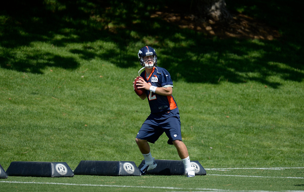. Zac Dysert (2) quarterback of the Denver Broncos works on drills during mini camp June 11, 2013 at Dove Valley. (Photo By John Leyba/The Denver Post)