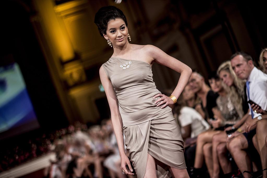 . A model shows off designs during the JWLSCPH show during Copehagen Fashion Week Spring/Summer 2014 in Copenhagen, Wednesday, Aug. 7, 2013. (AP Photo/Anthon Unger, POLFOTO)