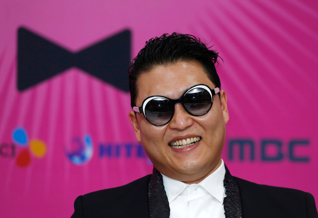 """. South Korean rapper PSY smiles during a news conference for his concert \""""Happening\"""" in Seoul, South Korea Saturday, April 13, 2013. PSY is unveiling the music video and choreography for his new single \""""Gentleman\"""" at the Seoul concert. (AP Photo/Kin Cheung)"""