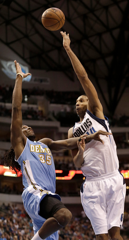 . Dallas Mavericks center Brandan Wright (34) shoots over Denver Nuggets small forward Kenneth Faried (35) during the second half of an NBA basketball game on Friday, April 12, 2013, in Dallas. The Mavericks won 108-105 in overtime.  (AP Photo/LM Otero)