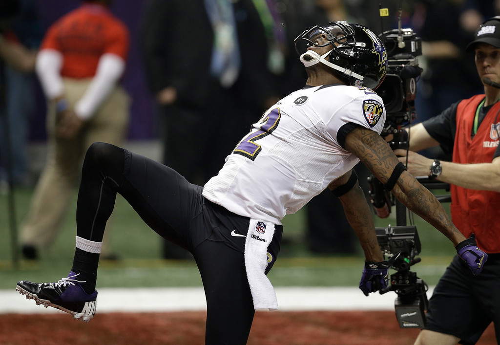 . Baltimore Ravens wide receiver Jacoby Jones (12) reacts after returning a kickoff for a 108-yard touchdown against the San Francisco 49ers during the second half of the NFL Super Bowl XLVII football game, Sunday, Feb. 3, 2013, in New Orleans.(AP Photo/Elaine Thompson, File)