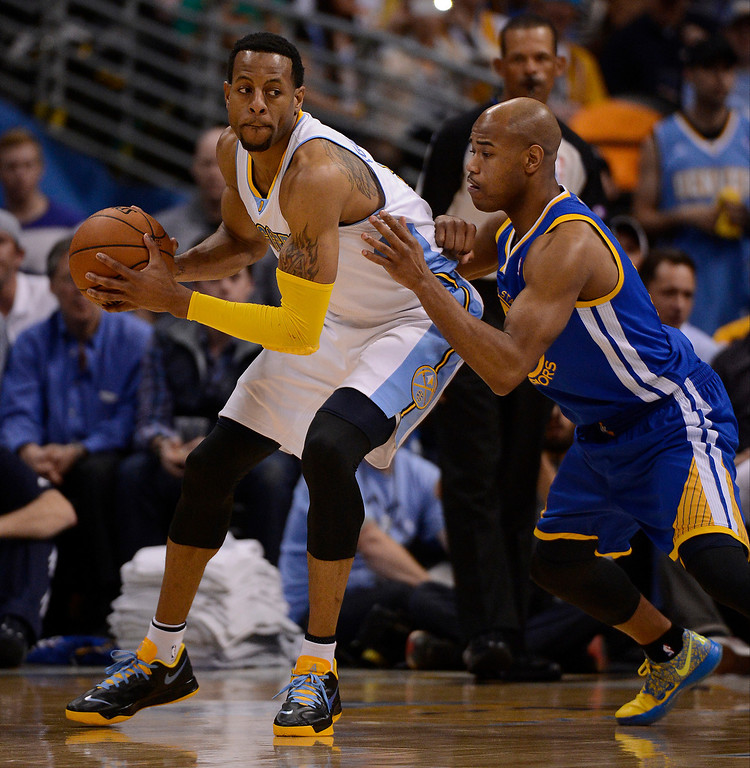 . Denver Nuggets shooting guard Andre Iguodala (9) is defended by Golden State Warriors point guard Jarrett Jack (2) in the third quarter. The Denver Nuggets took on the Golden State Warriors in Game 5 of the Western Conference First Round Series at the Pepsi Center in Denver, Colo. on April 30, 2013. (Photo by John Leyba/The Denver Post)